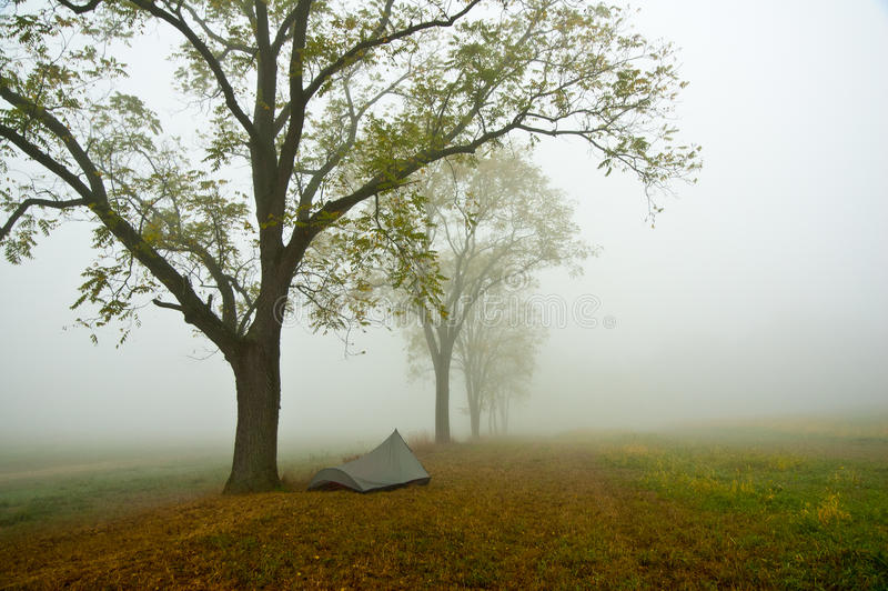 Tent in misty Gettysburg Battlefield. Scenic view of tent under autumn trees in misty countryside, Gettysburg, PA, U.S.A stock image