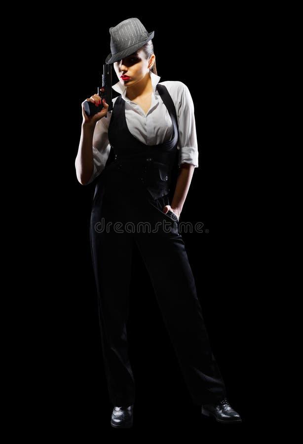 Gevaarlijk en mooi misdadig meisje met kanon royalty-vrije stock afbeelding