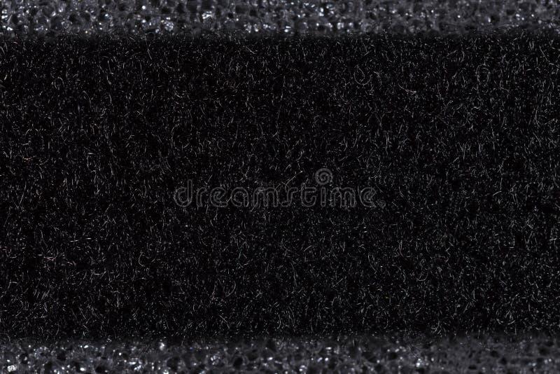 Gevoelde zwarte macro op de macroclose-up van het polyurethaanschuim stock afbeeldingen