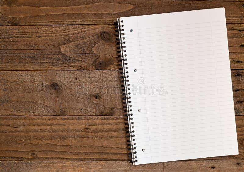 Gevoerde A4 notitieboekjeachtergrond royalty-vrije stock foto