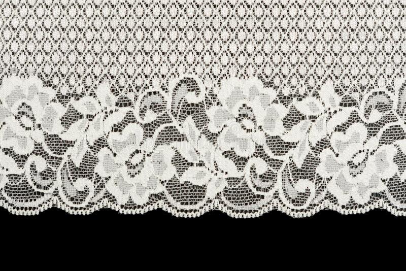 Gevormd wit kant op zwarte achtergrond royalty-vrije stock afbeelding