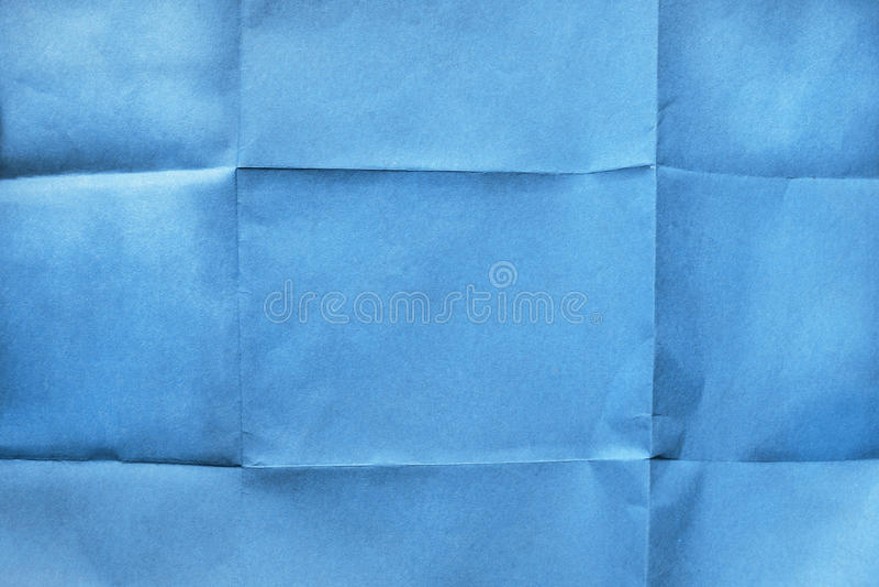 Gevouwen blauw document royalty-vrije stock fotografie