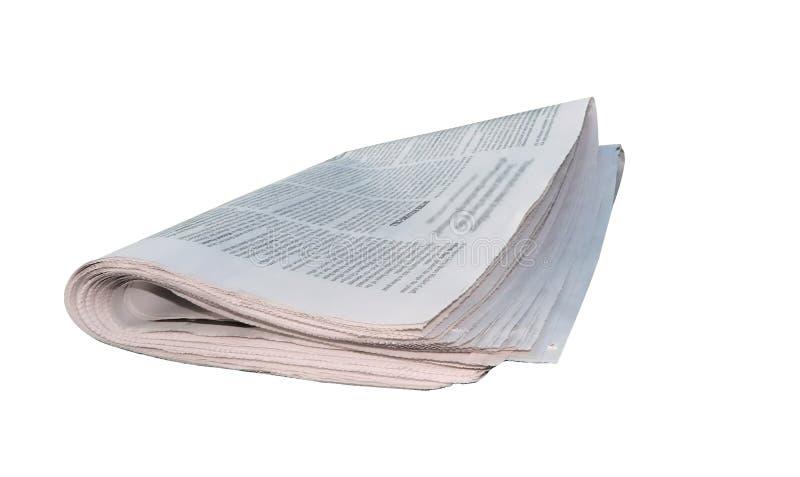 Gevouwen krant - geïsoleerdd over wit stock afbeelding