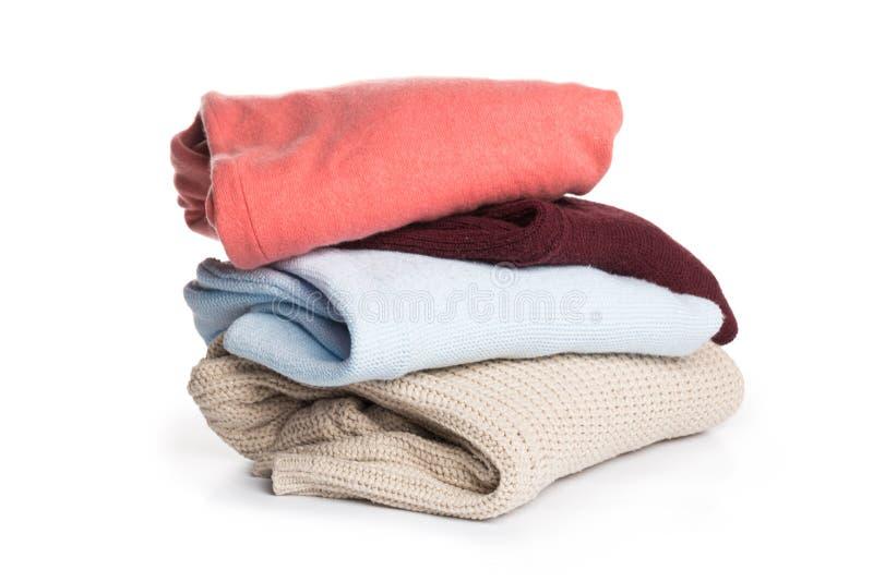 Gevouwen sweater op isolatieachtergrond stock afbeeldingen