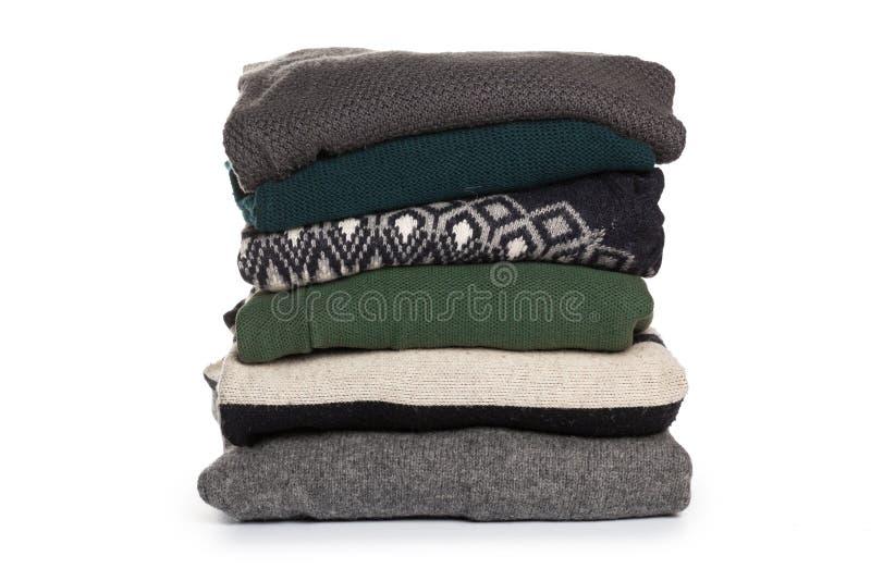 Gevouwen sweaterpatroon op witte isolatie als achtergrond royalty-vrije stock foto
