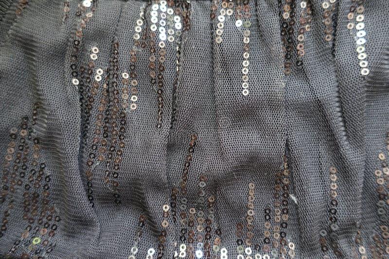 Gevouwen zwarte polyester net-like spangled textiel stock fotografie