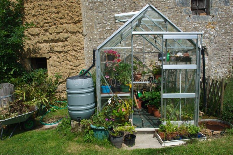 Gewächshaus im Bretagne-Garten lizenzfreie stockbilder