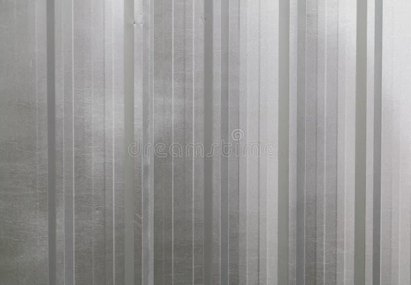 Gewölbtes Metallwanddetail des gezeichneten glänzenden Stahls lizenzfreie stockfotografie