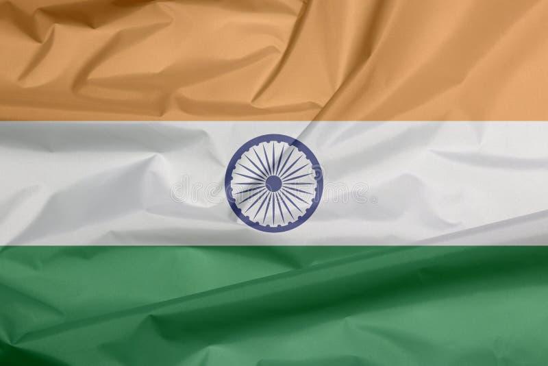 Gewebeflagge von Indien Falte des indischen Flaggenhintergrundes lizenzfreie abbildung
