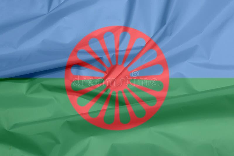 Gewebeflagge von Romani Leuten Falte des Zigeunerflaggenhintergrundes lizenzfreies stockbild