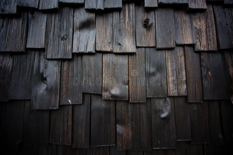 Geweven achtergrond van nat donker hout stock foto