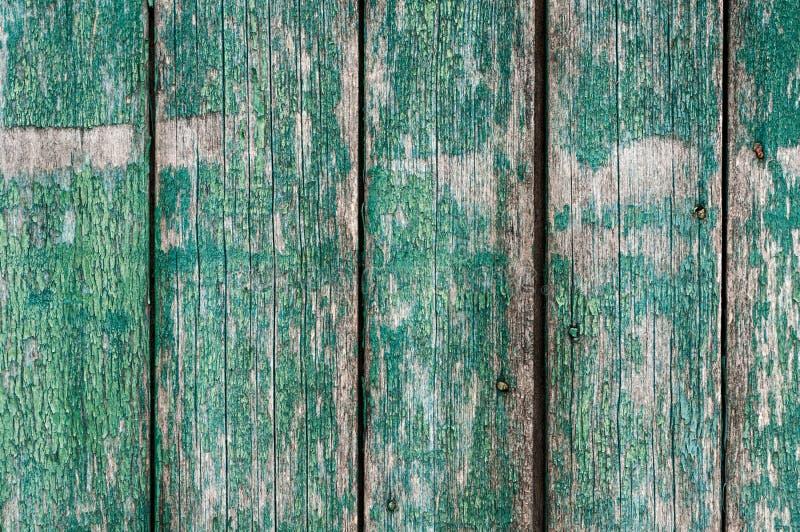 Geweven doorstane houten surfase met verticale raad, gebarsten blauwgroen royalty-vrije stock fotografie