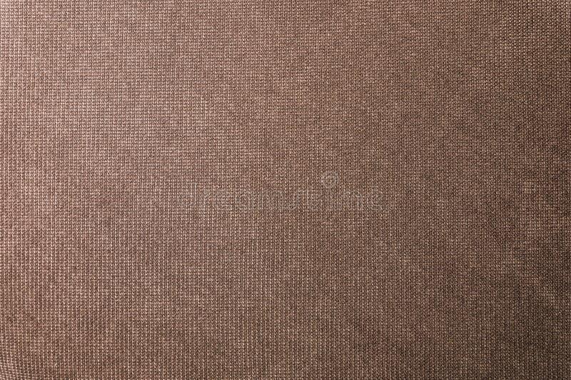 Geweven grote bruine textiel als achtergrond Textuur van textielstoffenclose-up stock afbeelding