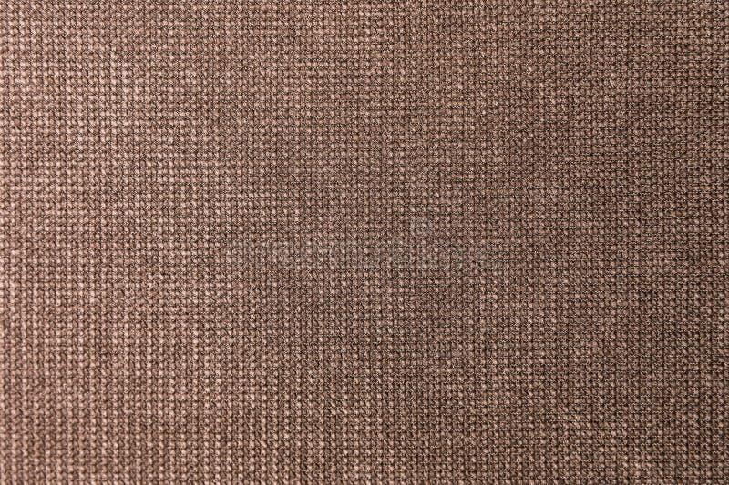 Geweven grote bruine textiel als achtergrond Textuur van textielstoffenclose-up royalty-vrije stock fotografie