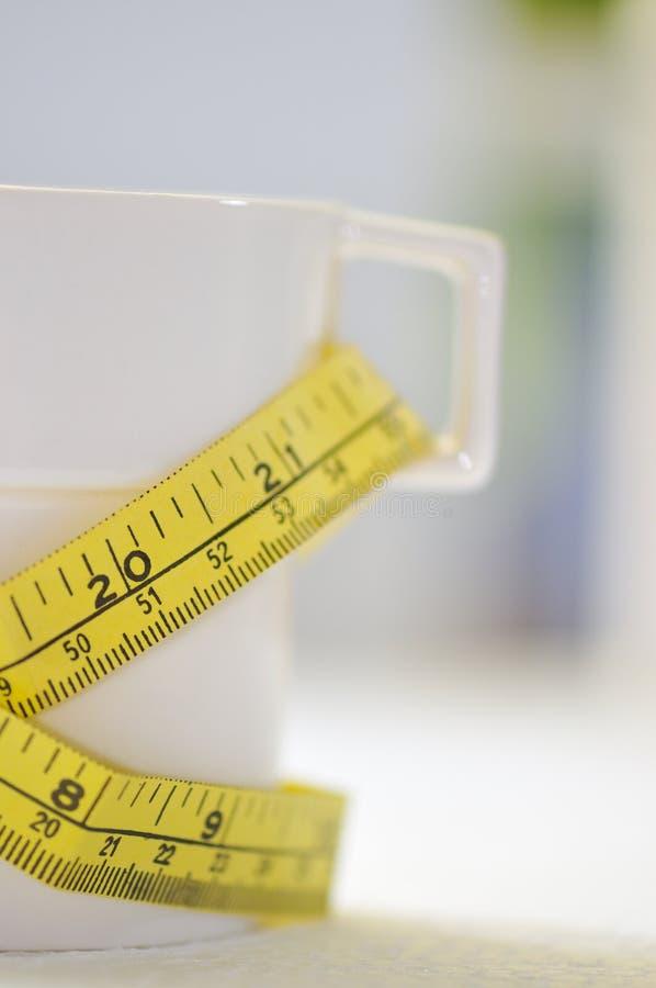 Gewicht-Verlust in einem Cup II lizenzfreie stockbilder