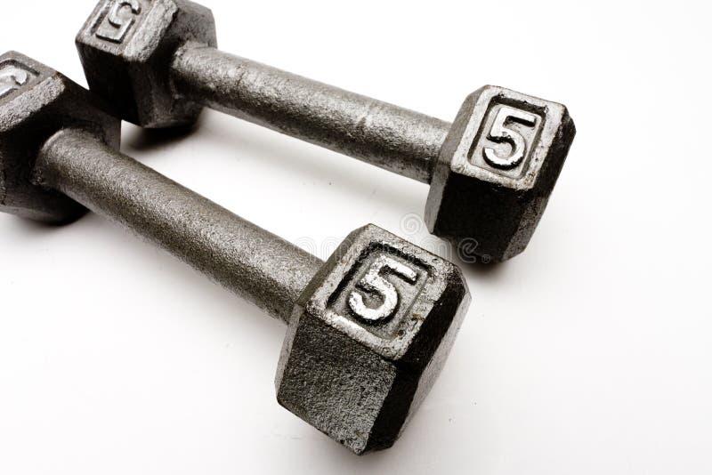 Gewichte der Nahaufnahme zwei Handtrennten weißen Hintergrund lizenzfreie stockbilder