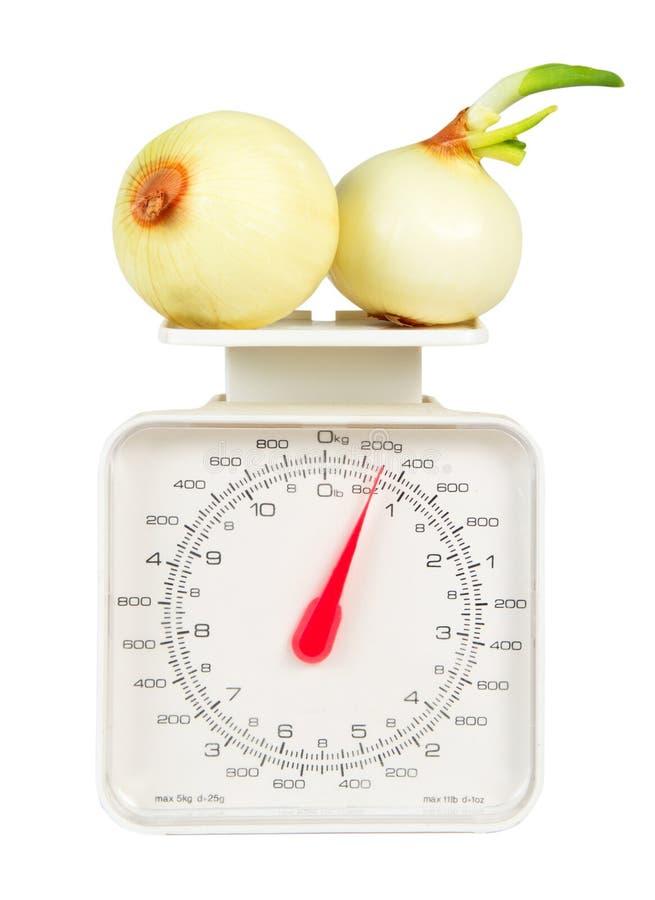 Gewichte mit vegies lizenzfreies stockfoto