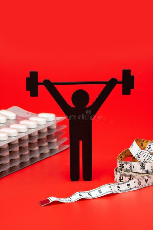 Gewichtheffenpictogram met pillen, meetlint stock afbeeldingen