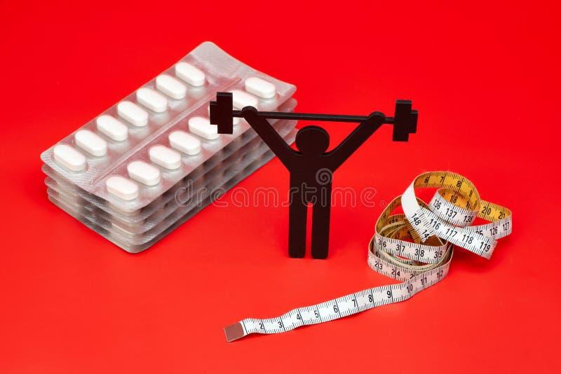Gewichtheffenpictogram met pillen, meetlint royalty-vrije stock fotografie
