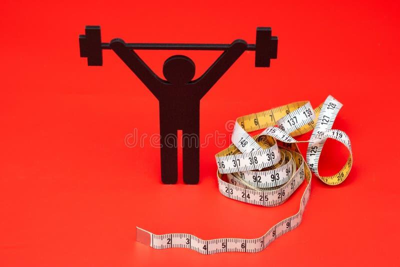 Gewichtheffenpictogram met pillen, meetlint royalty-vrije stock afbeelding