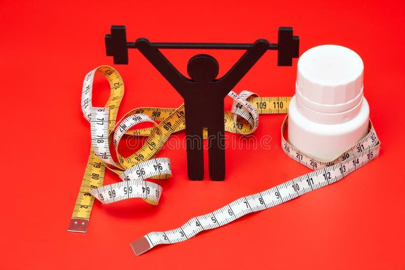 Gewichtheffenpictogram met pillen, meetlint stock fotografie