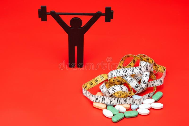 Gewichtheffenpictogram met pillen, meetlint royalty-vrije stock foto