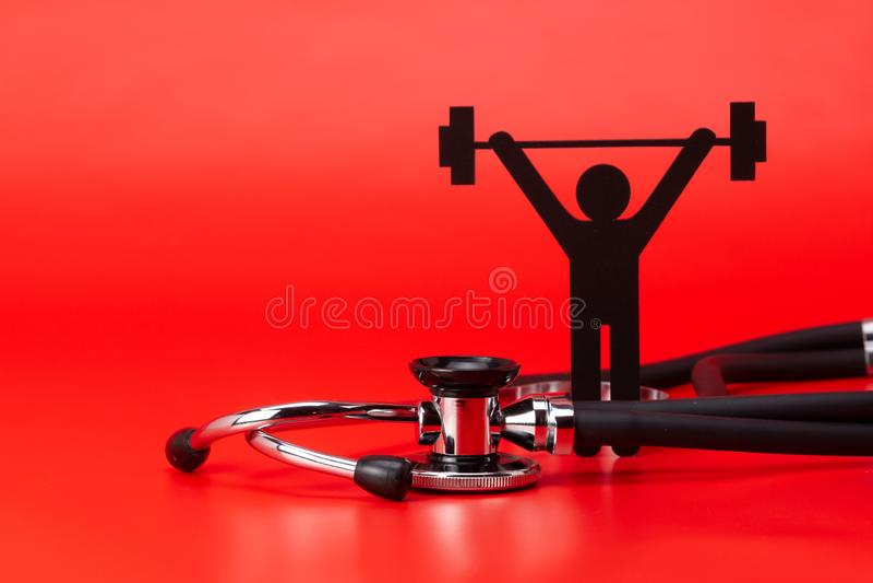 Gewichtheffenpictogram, Stethoscoop, geïsoleerd close-up royalty-vrije stock foto's