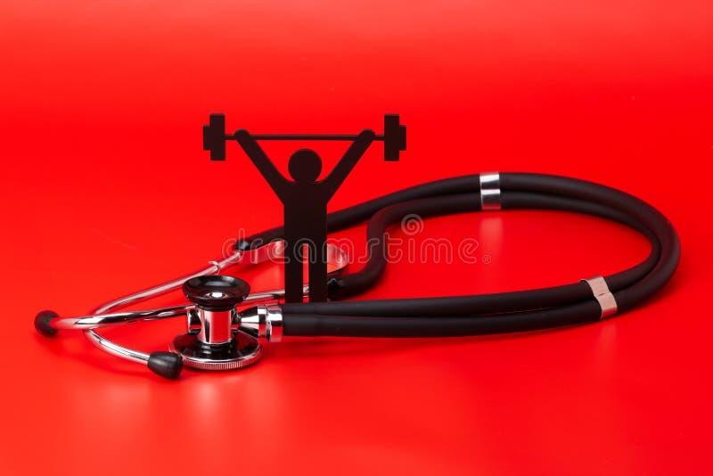 Gewichtheffenpictogram, Stethoscoop, geïsoleerd close-up stock fotografie