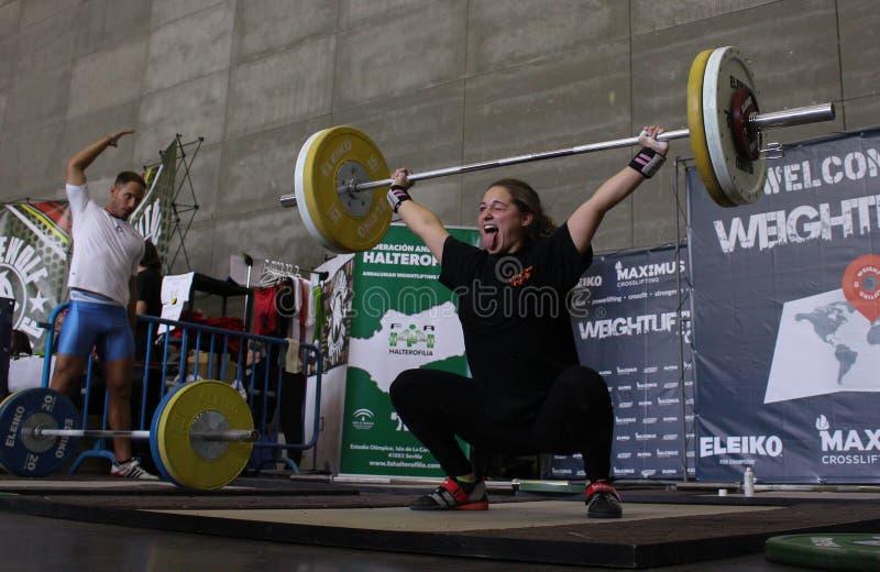 Gewichtheffenvrouw stock foto