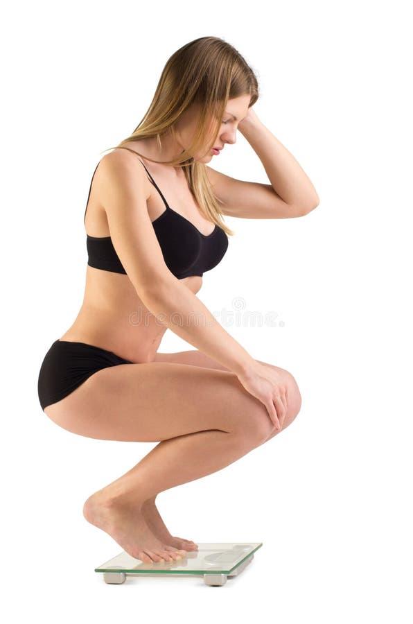 Gewichtmessen stockbild