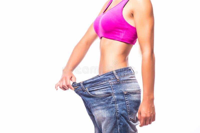 Gewichtverlust Frauentorso mit dem Maß, getrennt auf Weiß stockfotografie