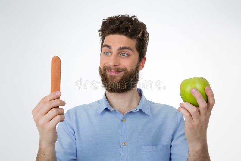 Gewinne der ungesunden Fertigkost nach einer gesunden Wahl stockbild