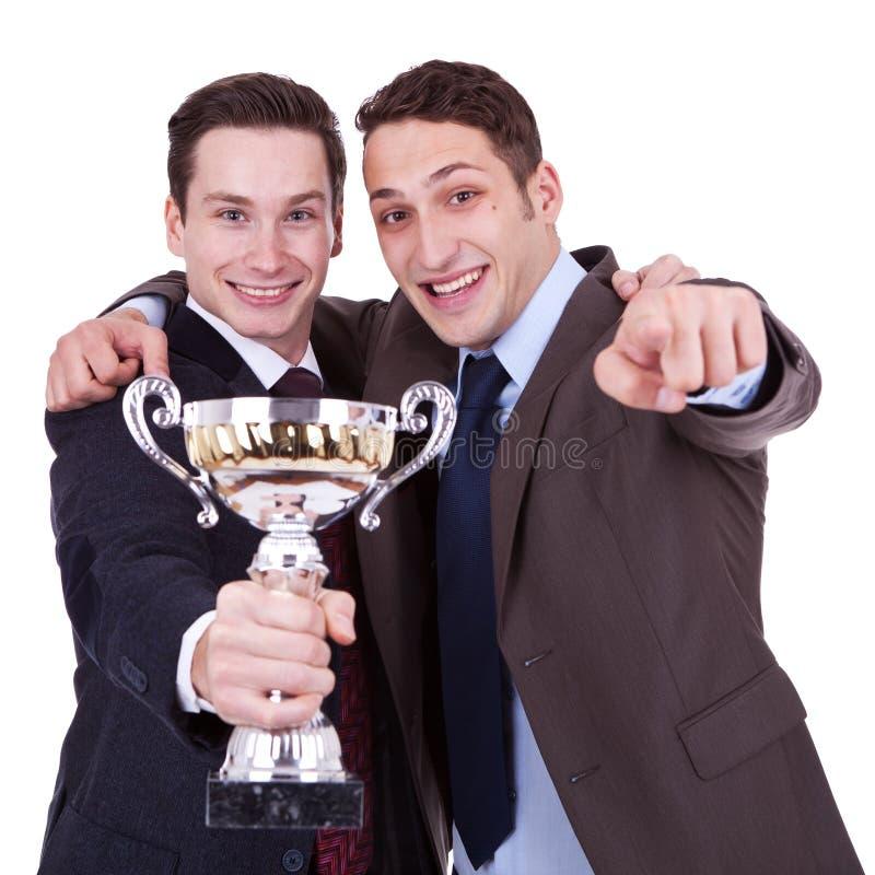 Gewinnende Geschäftsleute, die auf Sie zeigen lizenzfreie stockfotos