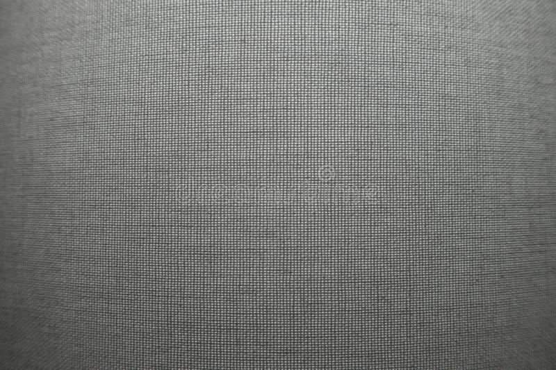 Grey textile pattern background surface. Gey textile woven backdrop wallpaper royalty free stock photography