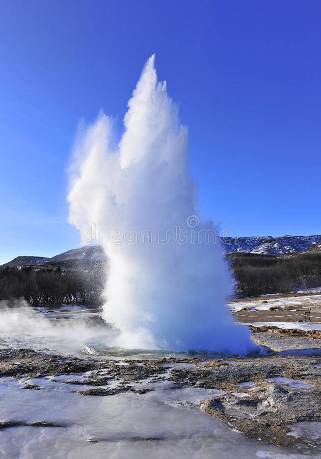 Geyser. Hot water eruption from geyser stock images