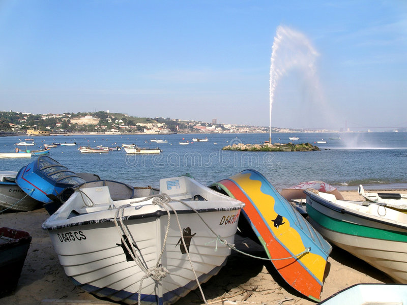 Geyser And Boats. In a small bay. Paço d'Arcos, Portugal royalty free stock images