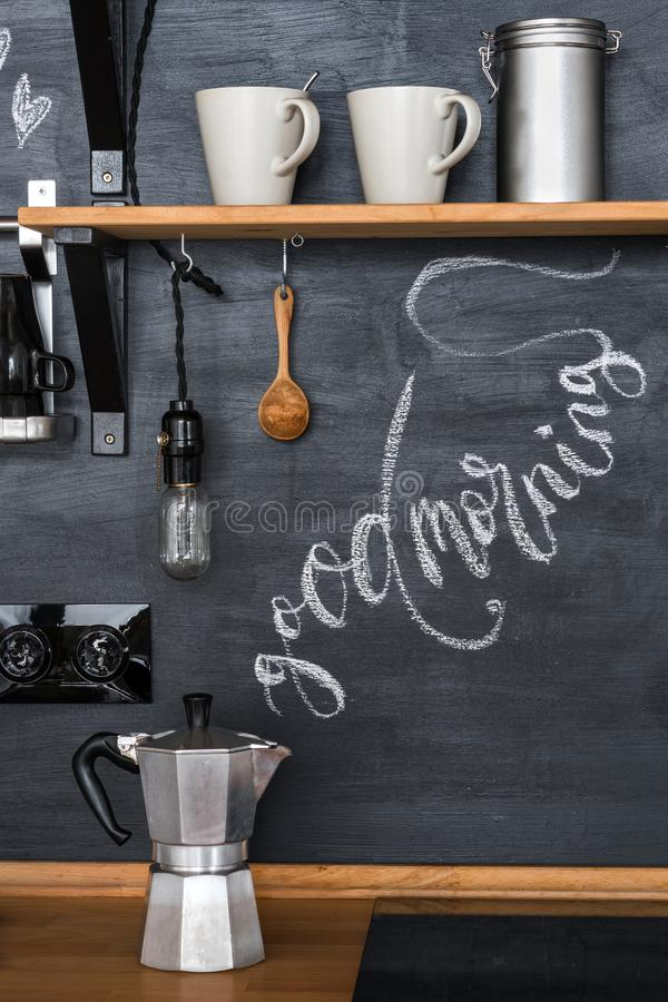 Geyser coffee maker on a chalky kitchen wall background in a loft style. The inscription `Good Morning`. With chalk in the form of steam from hot coffee royalty free stock photography