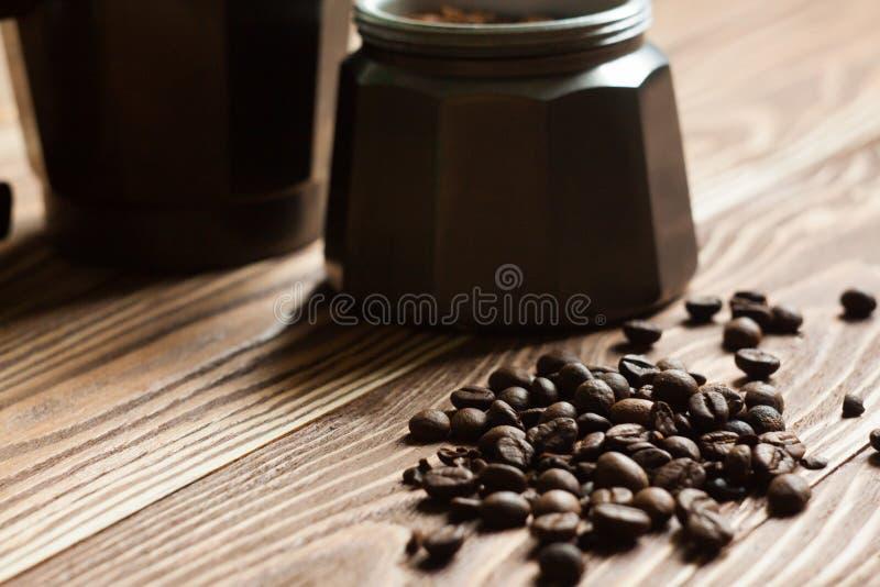 Geyser coffee maker. With coffee on the table. Moka on table stock photos