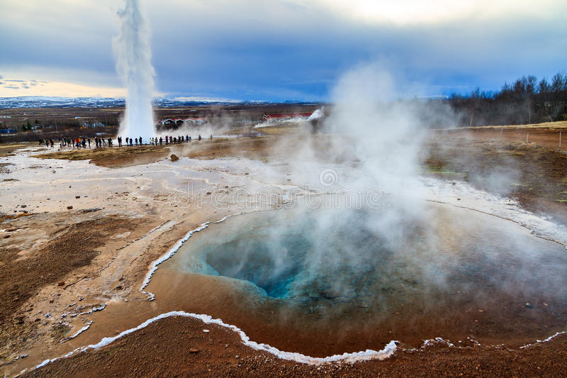 Geyser Iceland. Blue pool at the Haukadalur geothermal area, part of the golden circle route, with the Strokkur Geyser in the background in Iceland stock photography
