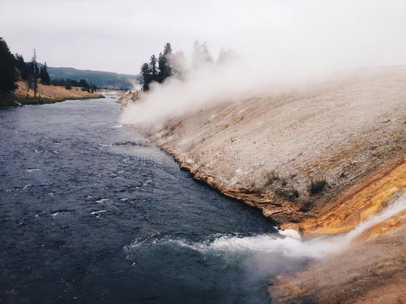 Geyser meets the river stock photos