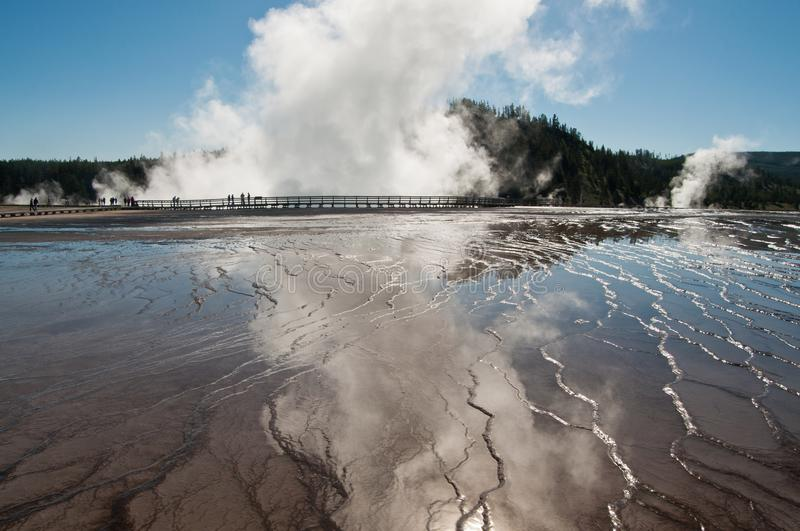 Geyser and reflective pool at yellowstone national park stock photos