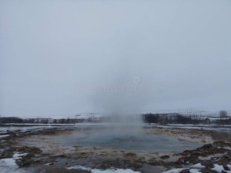 Geysir Strokkur National Park Iceland. Geyser in Strokkur National Park in Geysir,  Iceland. Winter season. Field with snow. Erupting hot water and steam royalty free stock photo
