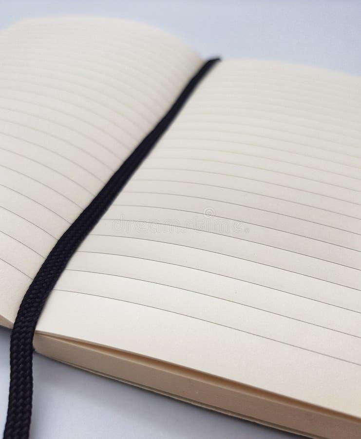 Gezeichneter Notizblock mit Bookmark lizenzfreie stockfotos