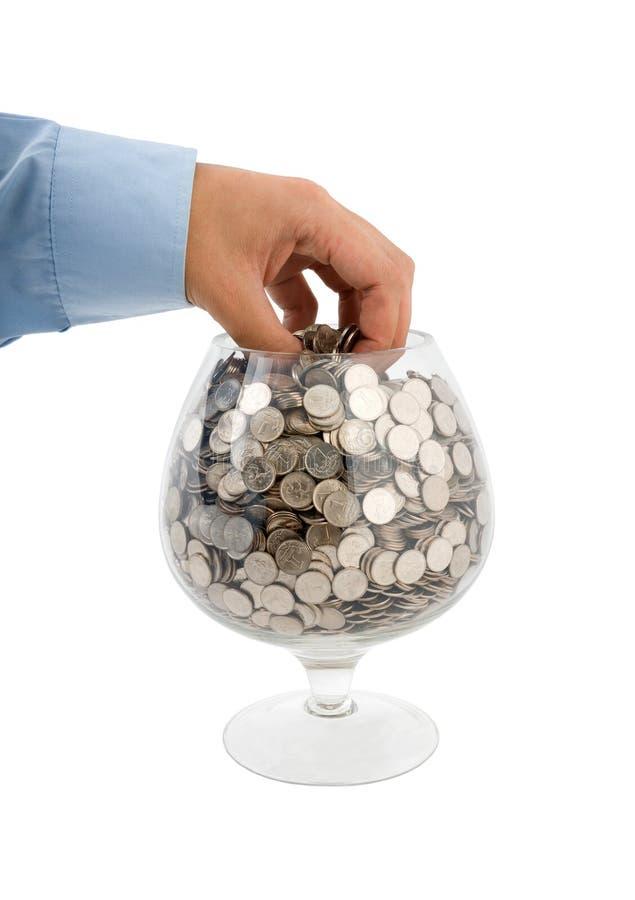 Gezet geld in glas stock afbeeldingen
