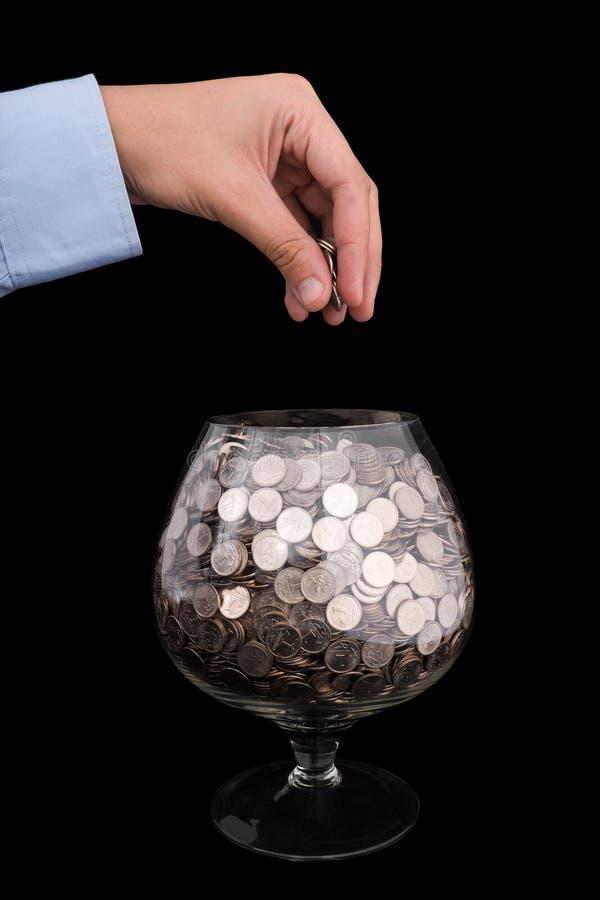 Gezet geld in glas stock afbeelding