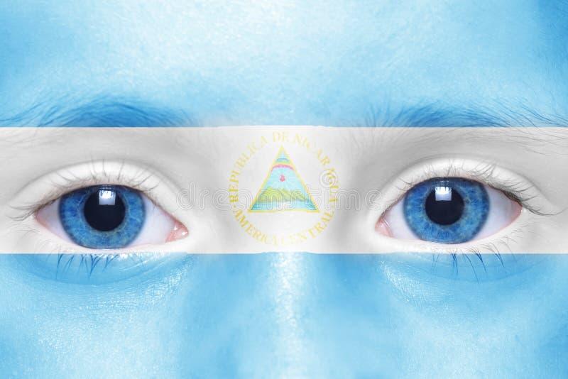 Gezicht met nicaraguan vlag stock afbeelding