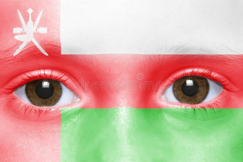 Gezicht met omani vlag stock afbeelding