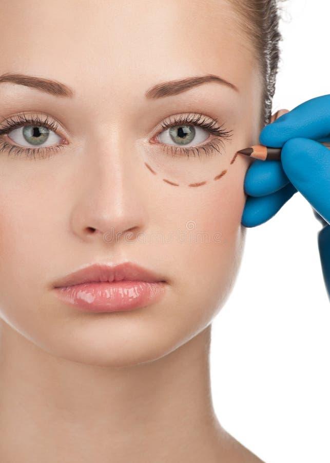 Gezicht vóór plastische chirurgieverrichting royalty-vrije stock afbeeldingen