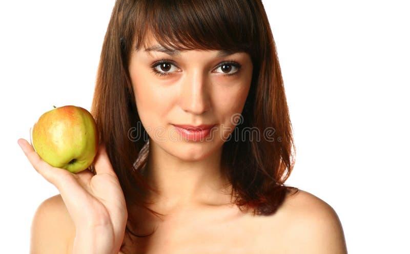 gezicht van brunette met appel royalty-vrije stock foto's