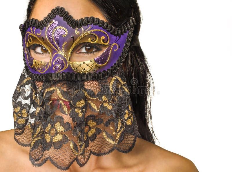 Gezicht van de vrouw verborg Venetiaans masker stock fotografie